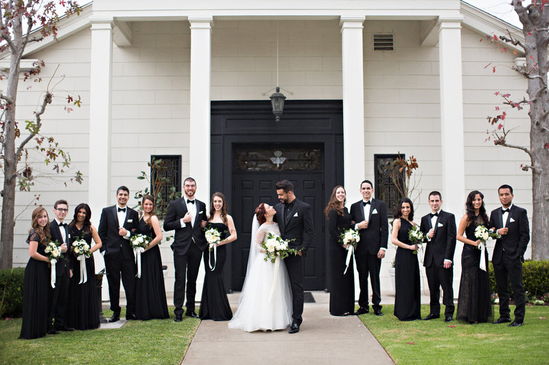Wedding Party in Black and White tuxes and dresses in front of church