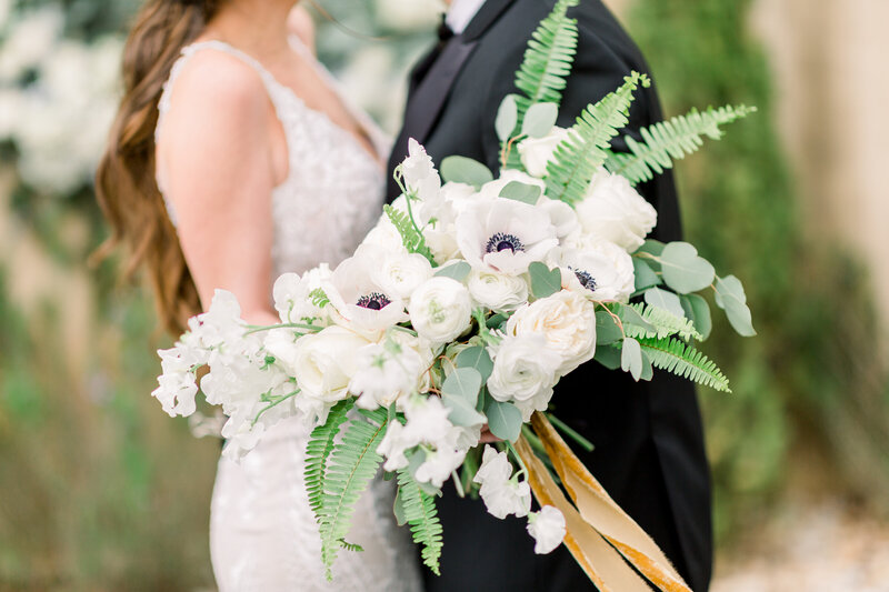 Couple with bridal bouquet during ceremony