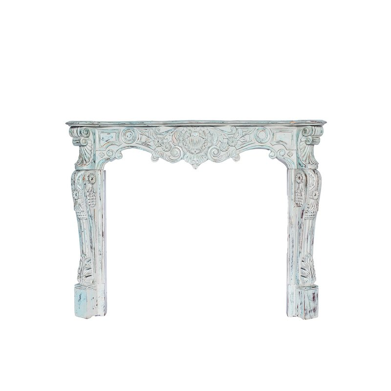 Beautiful ornate mantle in sofa blue with gold undertones.