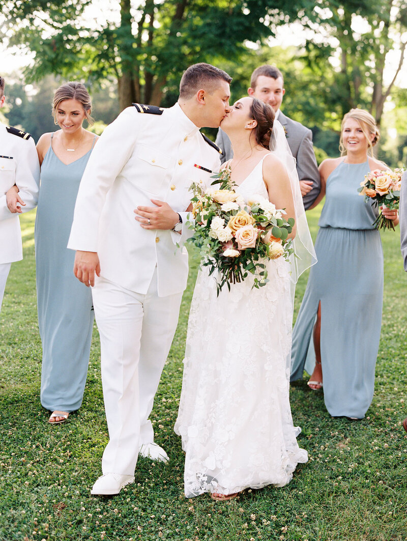 Navy Wedding Kiss with bridal party