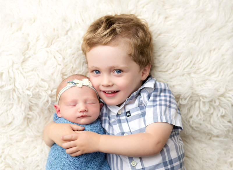 Baby brother with newborn sister