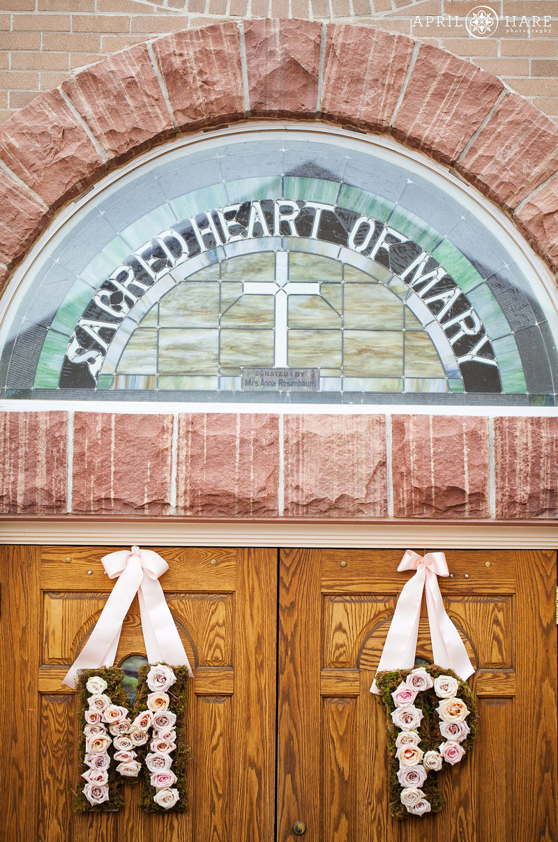 Front door decorated for wedding at Sacred Heart of Mary in Boulder CO