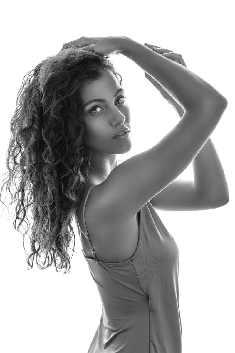 b+w portrait of a confident and curly hair women