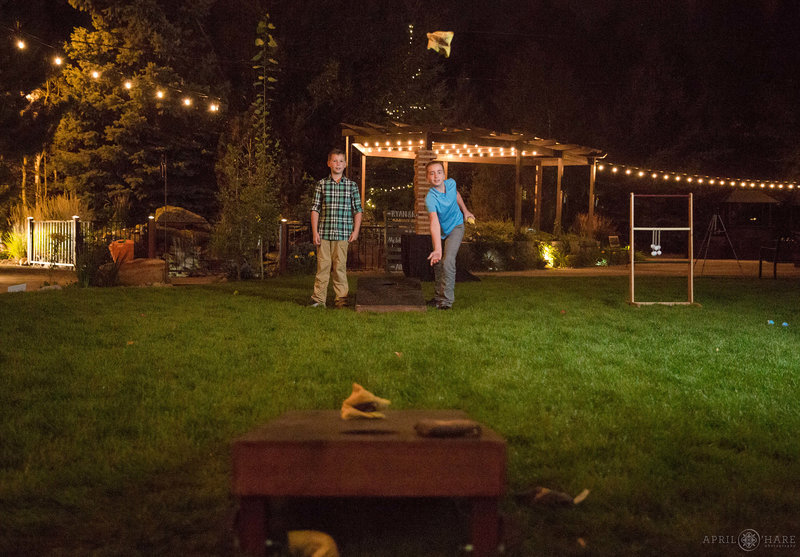 Kids play corn hole at Church Ranch Event Center wedding