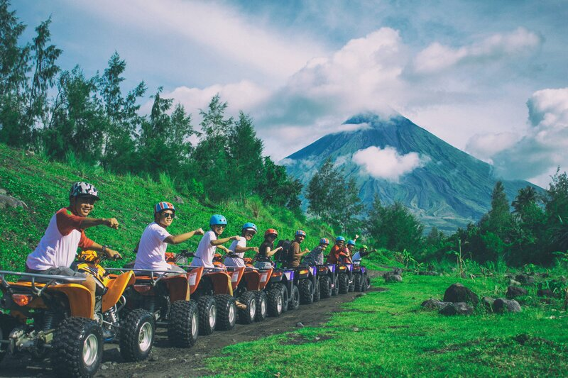 line-of-men-riding-on-all-terrain-vehicles-holding-out-hand-910623