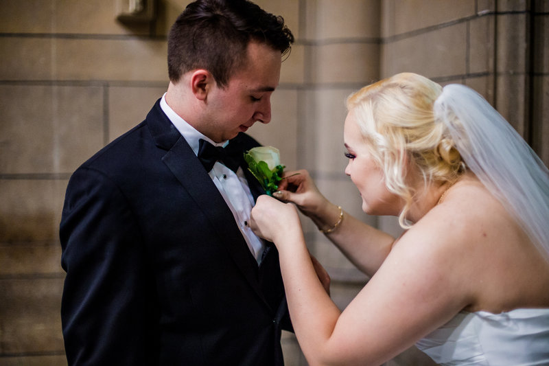 Pittsburgh, PA Bride fixes groom's boutonniere