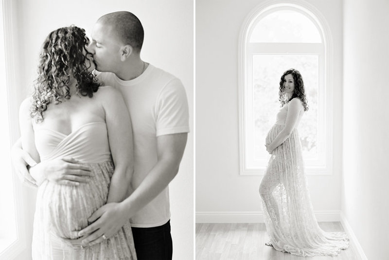 Black and white image of a couple kissing during their in studio maternity sessio