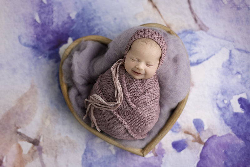 columbus-ohio-newborn-photographer-baby-girl-wrapped-in-lavendar-and-soft-floral-background-amanda-estep-photography