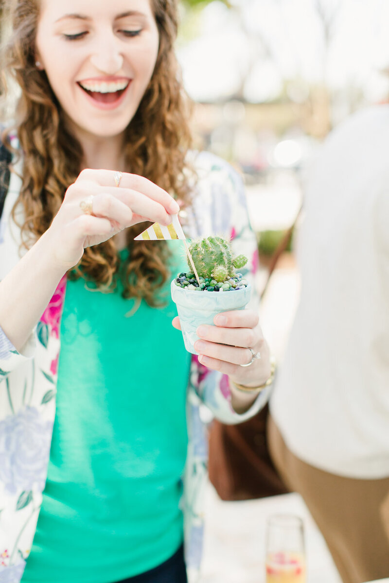 woman holding succulent
