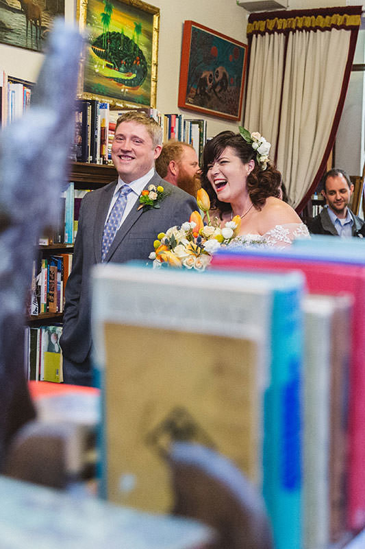 couple at ceremony in bookstore wedding