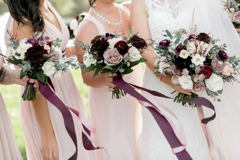 fall bridal bouquet and  bridesmaids bouquets featuring muted colors