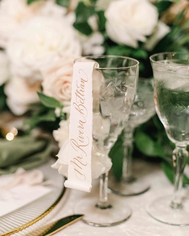 calligraphy scroll escort cards champagne glass by Dominique Alba