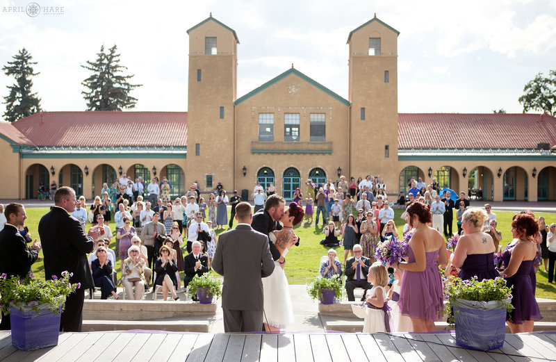 Bride and Groom Kiss at their outdoor City Park Pavilion Wedding Ceremony in Denver Colorado