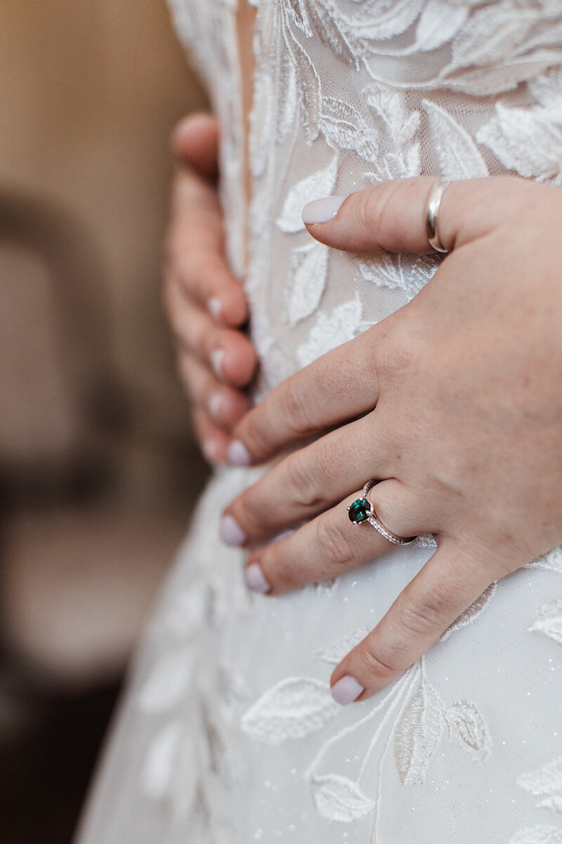 Detail photo of wedding ring and wedding dress at the Pierce house