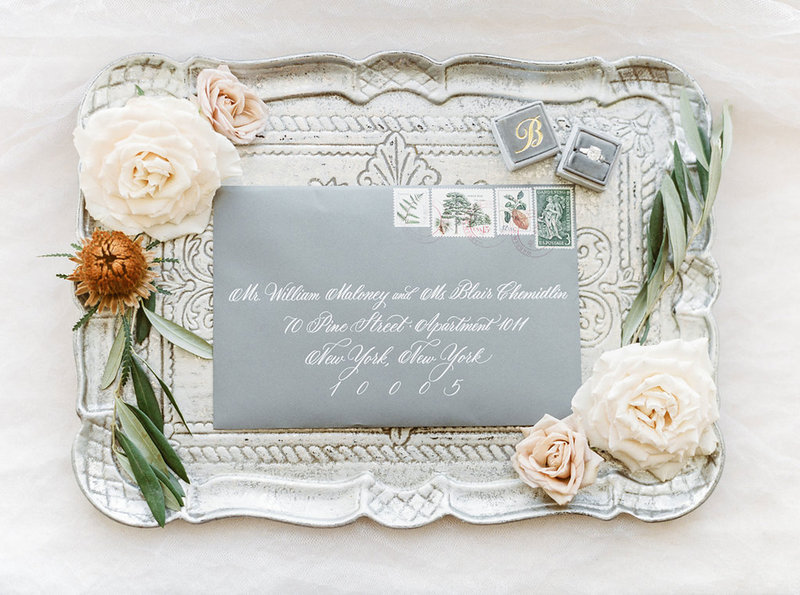 Custom white ink calligraphy on gray envelope