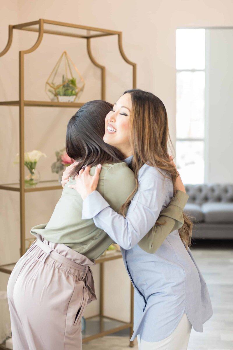 Dentist and Patient Hugging at Dental Office in Frisco