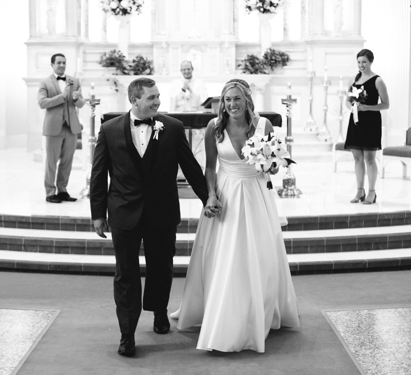 Recessional portrait of bride and groom at St. Patrick's Church wedding