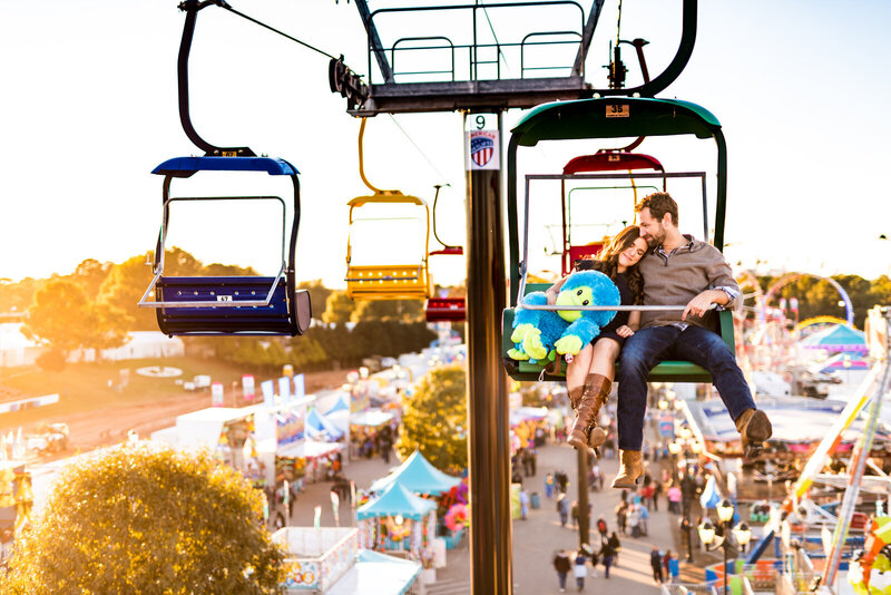 Engaged couple rides the high flyer at the North Carolina State Fair