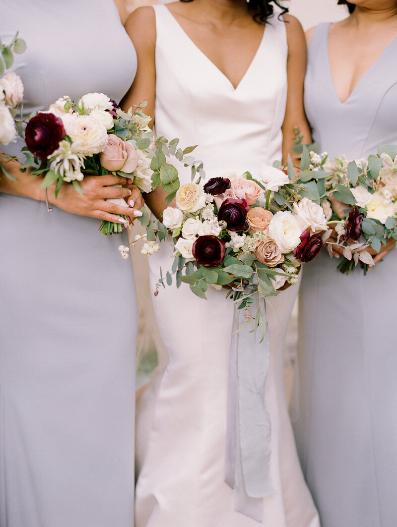 Grey Bridesmaid Dresses with Dusty Rose and Plum Bouquets