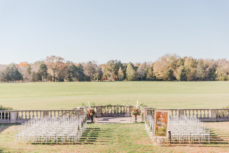 ceremony behind estate at great marsh estate wedding in northern virginia by costola photography