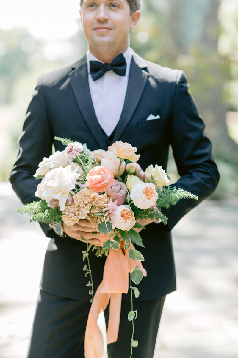 Virginia Wedding Photographer, groom holding the bride's bouquet