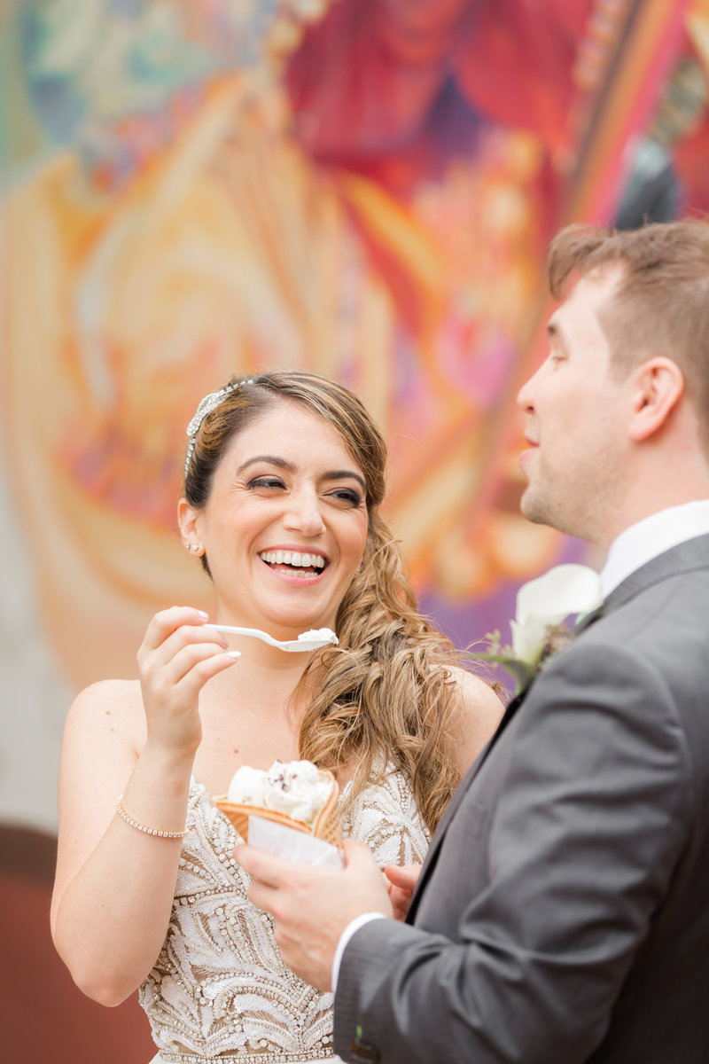 Bride eating ice cream on wedding day