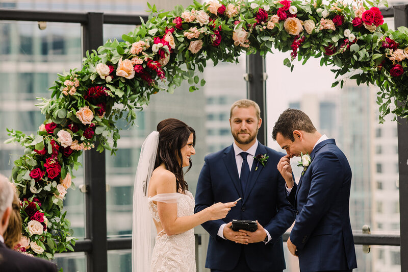 A wedding ceremony photo taken on a Chicago downtown rooftop.