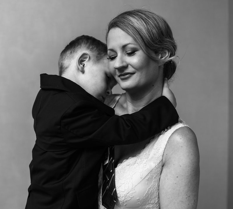 Bride holds her son at the Sheraton Erie Bayfront Hotel