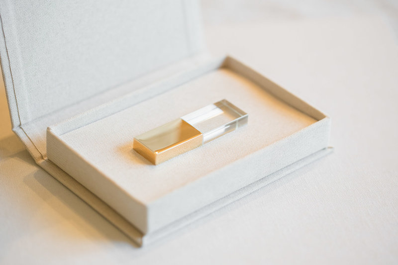 These gold and glass USB's are the perfect storage for your wedding day memories. Photo by Rebecca Cerasani.