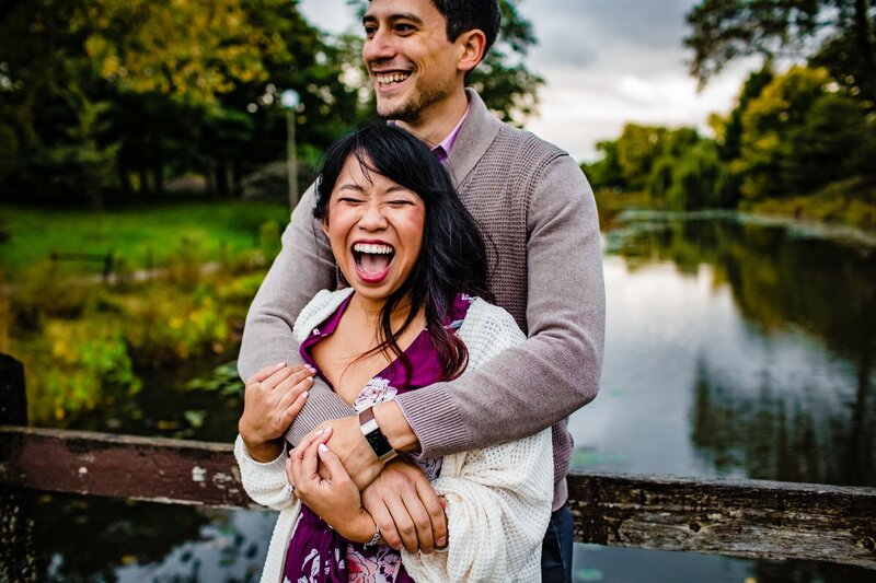A couple laughs together during a Humboldt Park engagement session.