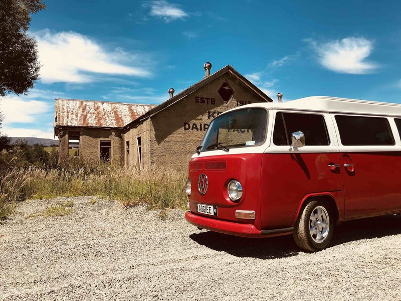 Aggiee, red kombi pictured outside the old Kelso Dairy Factory in South Otago, New Zealand