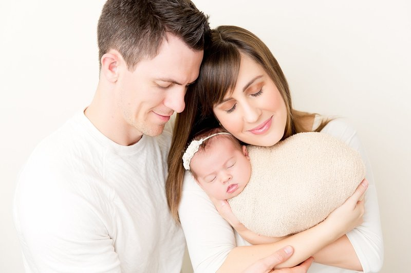 mom and dad with newborn