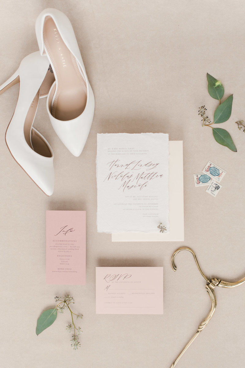 Flat lay with wedding shoes and wedding invitation