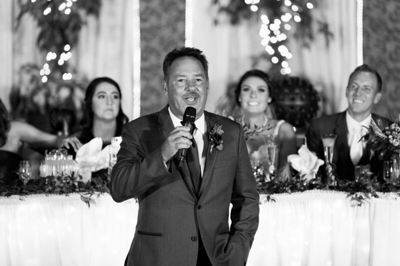 father speaking at wedding reception