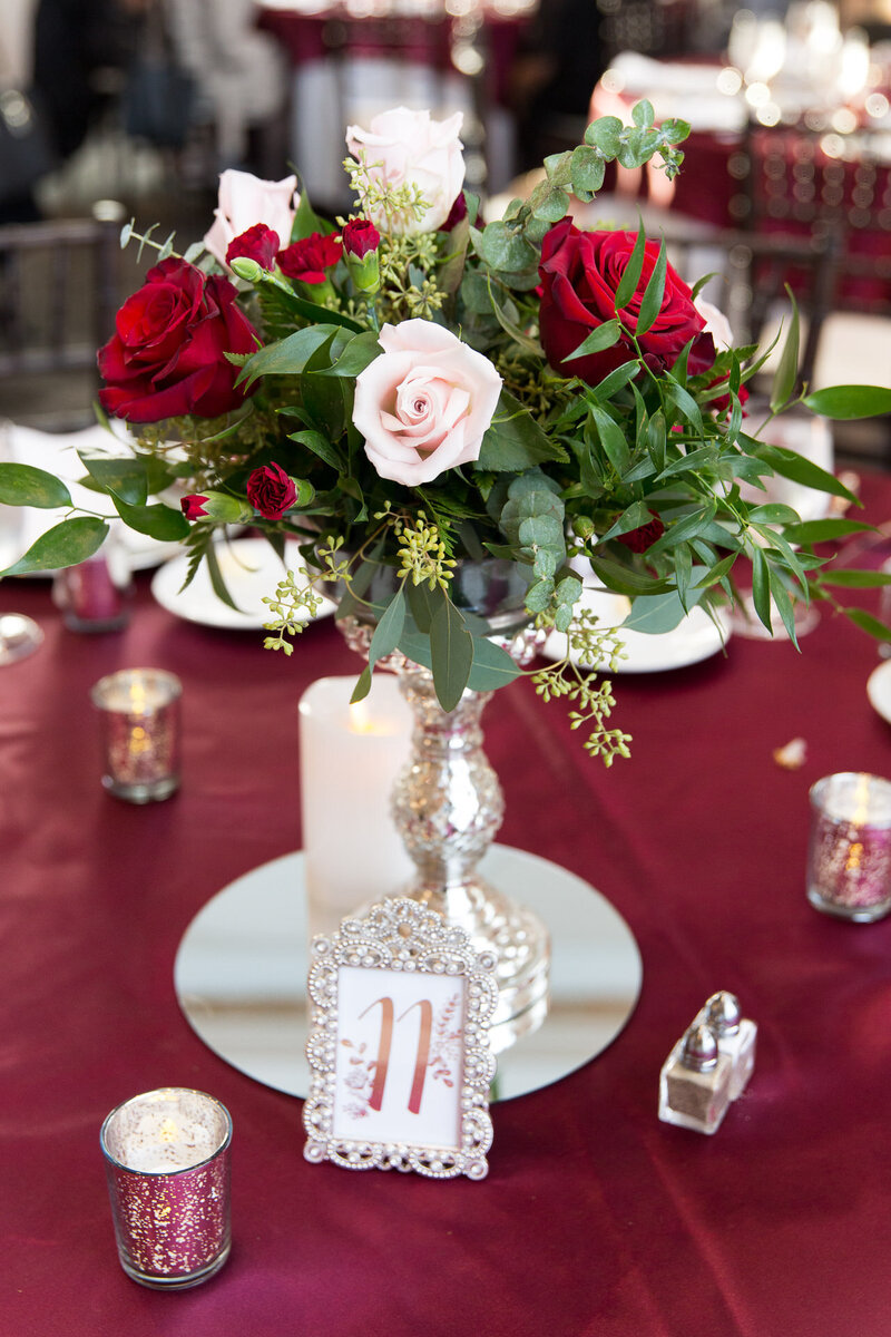 red roses table centerpiece at cityflats ballroom port huron