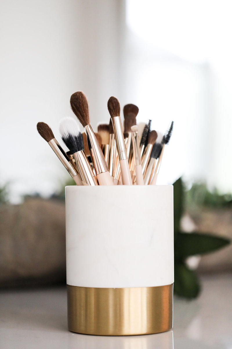 White jar of makeup brushes