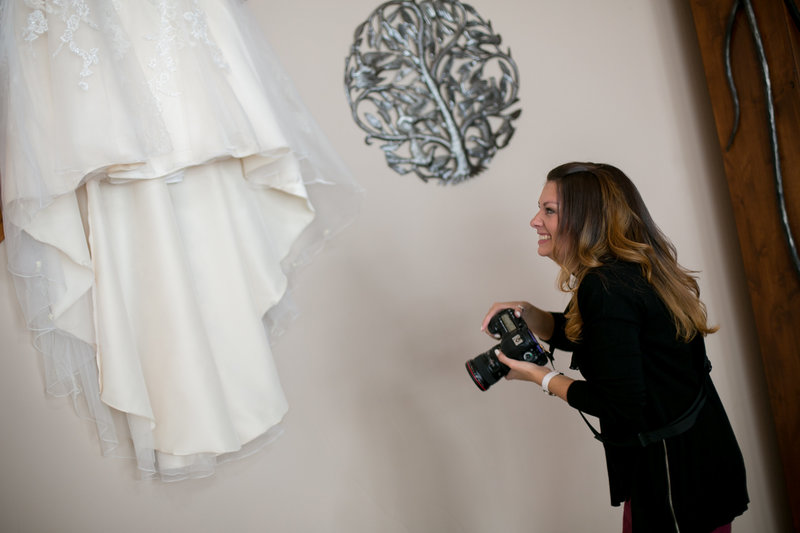melissa photographing a wedding dress