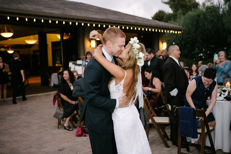 couple kissing at wedding venue in San Juan Capistrano