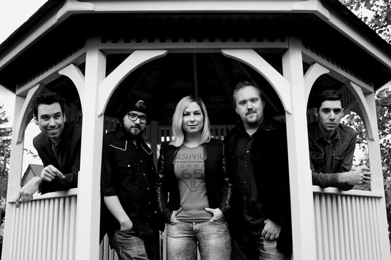 Band photo black and white The FAith Numade Band standing in gazebo