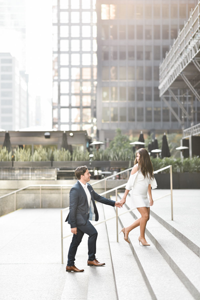 Couple in Toronto's financial district for their engagement shoot