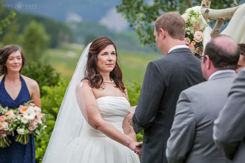 Sweet moment at outdoor wedding at Mountain wedding garden Crested Butte