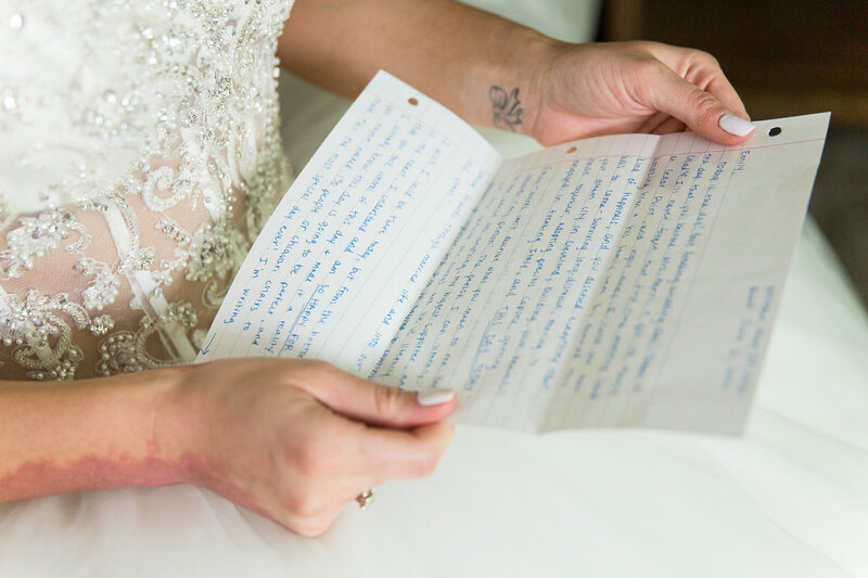 bride reading letter from friend on wedding morning