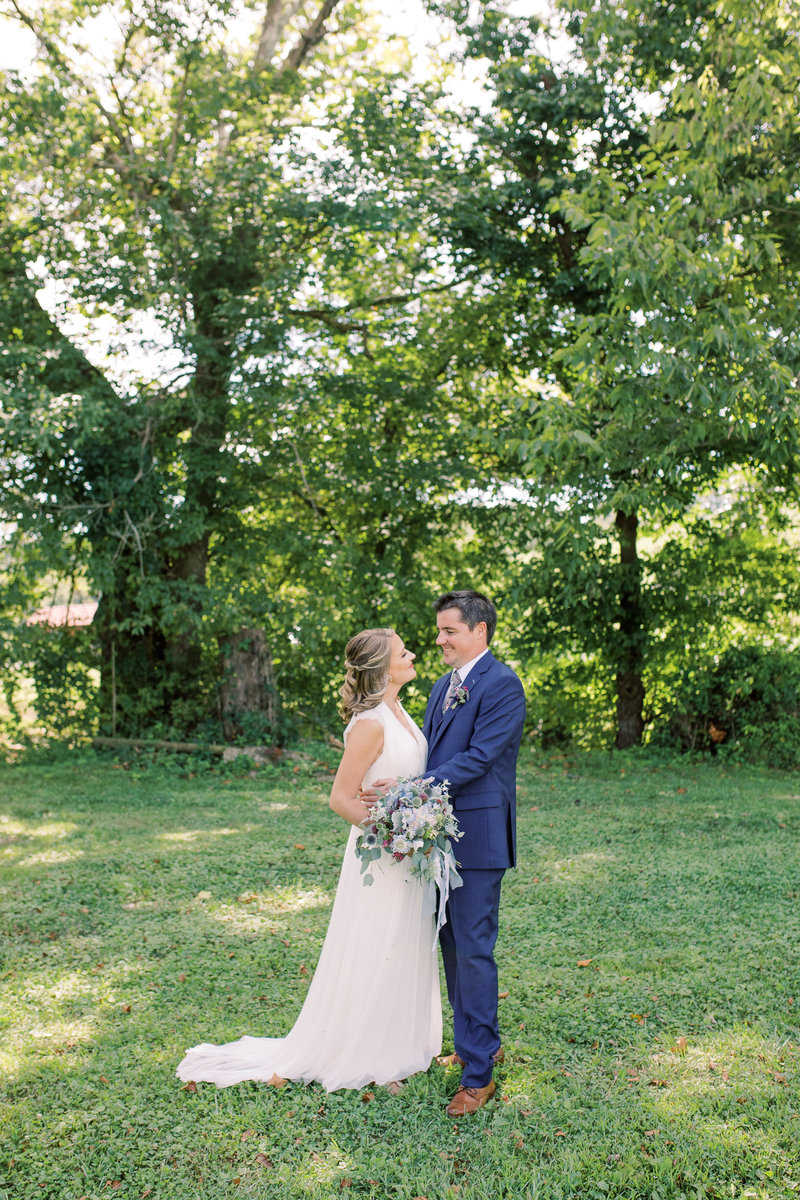 Wide shot of a bride and groom smiling towards each other on their wedding day at Neltner's Farm in Cincinnati