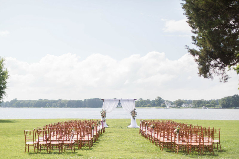wedding ceremony by the water at eastern shore wedding at kirkland manor by costola photography
