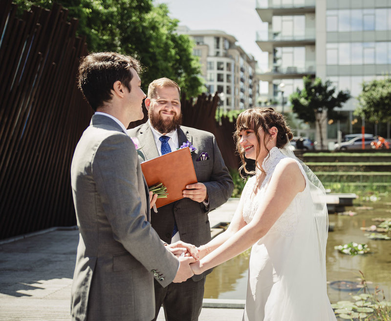 intimate wedding ceremony at Tanner Springs Park in Portland, Oregon