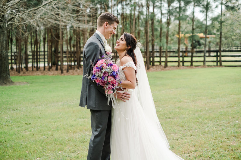 Bride and groom embrace after they are married at Club Lake Plantation