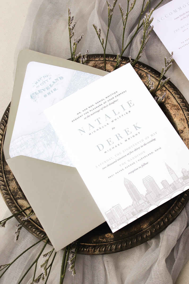 The Cleveland Skyline is beautifully illustrated at the base of the invitation while clean, modern typography sits right above. The perfect invitation for anyone who wants to show and share their Cleveland heritage on their wedding invitation.
