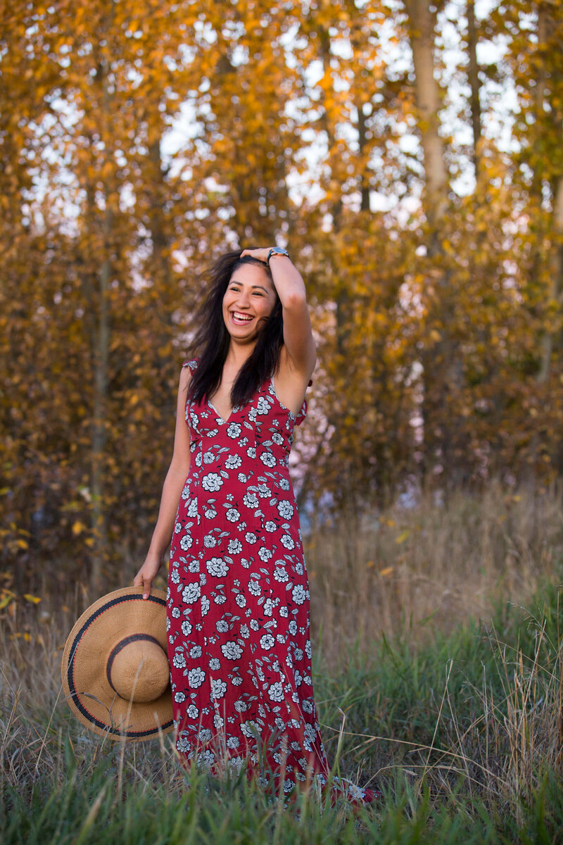 indigenous model laughing  standing in tall grass