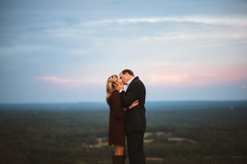 couple kissing on top of mountain by eliza morrill