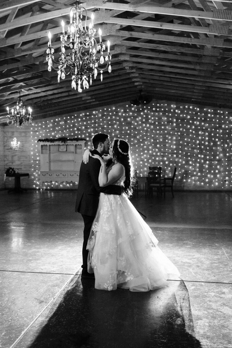 Couple doing last dance in Temecula wedding in an old barn